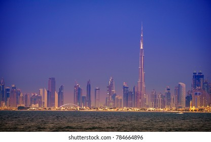 Seaside view of skyline of Dubai's downtown after sunset
