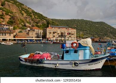 Seaside village hamlet of Assos Iskele or Behram Turkey with boats hotels and restaurants Assos (Behramkale), Canakkale, Turkey - November 12, 2012