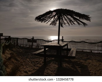 Seaside wooden table at sunset.
