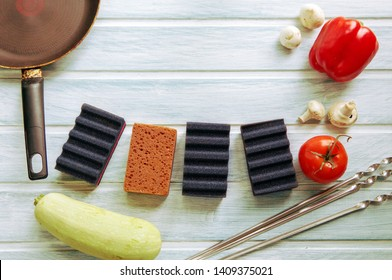 Season of grill barbeque picnic and cleaning products, sponges over wooden background