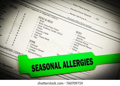 Seasonal allergies green bracelet over top hospital paperwork