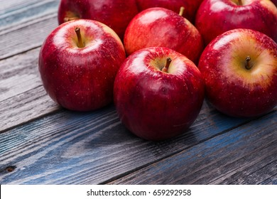 Seasonal. Autumn. Red apples on the rustic wooden table