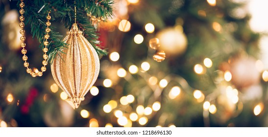 Seasonal background with Christmas toy on the tree. Celebration concept. Soft focus. Horizontal, wide screen banner format