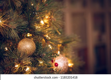 Seasonal background with Christmas toys on the tree. Celebration concept. Soft focus. Horizontal - Shutterstock ID 1185201418