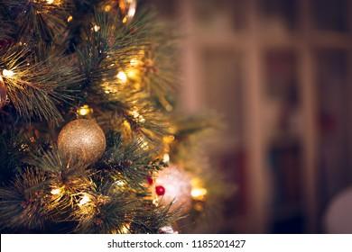 Seasonal background with Christmas toys on the tree. Celebration concept. Soft focus. Horizontal