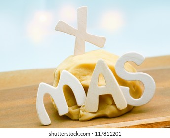 Seasonal background with freshly prepared dough left to rise on a kitchen countertop decorated with the letters XMAS for preparing Christmas cookies for family and friends