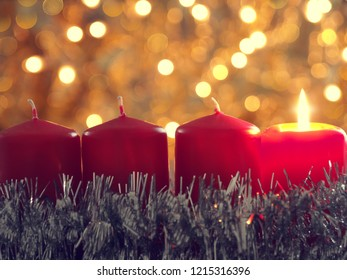 Seasonal background with red Advent candles and golden Christmas decoration