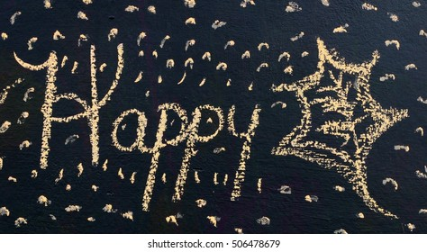 """Seasonal Black Chalkboard Scene With The Word """"Happy"""" And A Simple Leaf Drawn In Yellow Chalk With Specks All Around"""