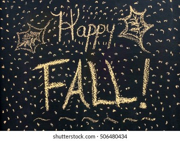 "Seasonal Black Chalkboard Scene With The Words ""Happy Fall"" With Simple Leaves Drawn On Sides With Yellow Chalk With Specks And Dots All Around Words"