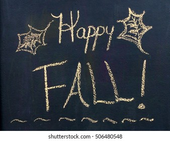 """Seasonal Black Chalkboard Scene With The Words """"Happy Fall"""" With Simple Leaves Drawn On Sides With Yellow Chalk"""