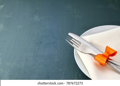 Seasonal blue wooden table dish, napkin and cutlery. Free space to menu or inscription.