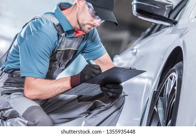 Seasonal Car Maintenance. Caucasian Auto Service Technician Looking For Potential Issues with the Serviced Vehicle.