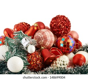 Seasonal Christmas decoration background as a pile of xmas tree decorations over white background