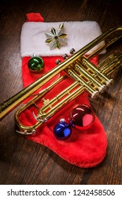 Seasonal Christmas and the holidays musical instrument trumpet with dramatic lighting
