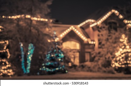 Seasonal Christmas House Lights Decoration, outdoor blurred defocused view. Xmas showcase