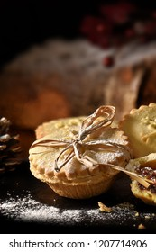 Seasonal Christmas mince pie with frosting shot in creative warm lighting with accommodation for copy space. The perfect image for your Christmas or festive menu cover art.