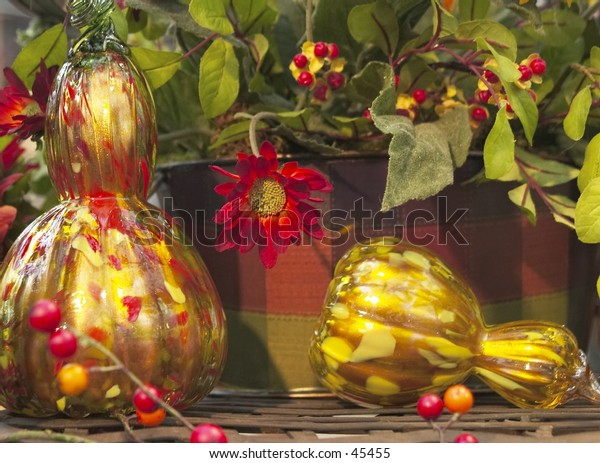 seasonal decorative gourds in glass