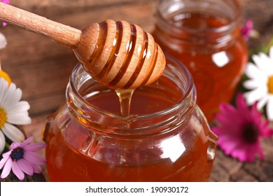 Seasonal fresh honey on a wooden surface