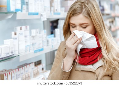 Seasonal health issues. Close up shot of a young woman sneezing in a paper napkin while shopping at the drugstore copyspace illness buying medications shopping customer client cold concept
