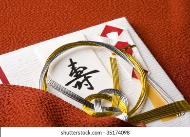 SEASONAL IMAGE- close-up shot of a  Japanese traditional special envelope with a red wrapping cloth