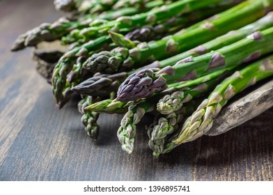 Seasonal product green Asparagus in wooden decorations, on wooden scoop green asparagus, lots of green asparagus