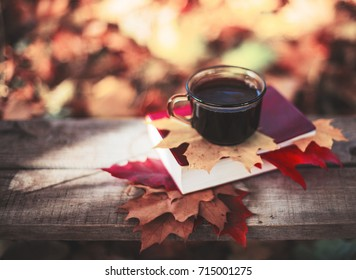 seasonal relax concept with fallen leaves and hot drinks