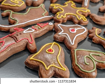 Seasonal shaped gingerbread cookies with colorful icing