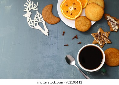 Seasonal table with cookies, gingerbreads and cup of coffee.