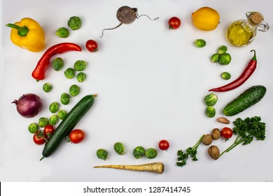 seasonal vegetables - broccoli, bell peppers, tomatoes, onions, garlic with spices and herbs. Ingredients to prepare vegetable side dish. Healthy vegetarian food concept. Vegetables background. isolat