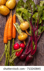 seasonal young vegetables on a dark background, vertically