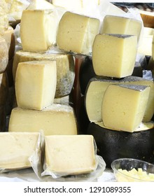 Seasoned pecorino cheese made with sheep's milk on sale in the market stall