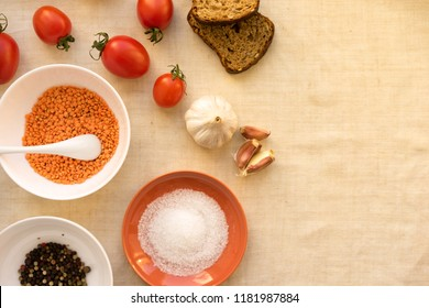 Seasoning background. Dry spices near ginger, garlic, rosemary, chili on white background top view copy space