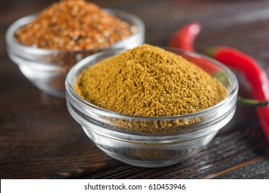 Seasoning. Space curry and mix of red pepper on dark wood