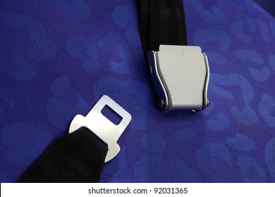 seat belt with blue background shot in airplane