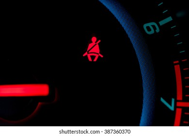 seat belt icon on the dashboard of a car