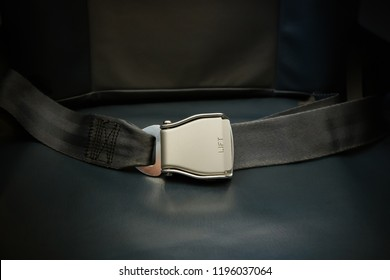 Seat belt on seat shot in airplane. Dark tone and Selective focus. Fastened safety belt. the concept of safe airplane flight