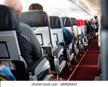 Seat on the plane with people in holiday