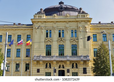 Seat of the Self-governing Region in Kosice, Slovakia. Flags of EU, Slovakia and Kosice Region. It is a former military headquarters building completed in 1908 as the most modern building in the town.