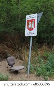 Seat under locality marking and traffic sign, Podkerepušky, Bratislava, Slovakia