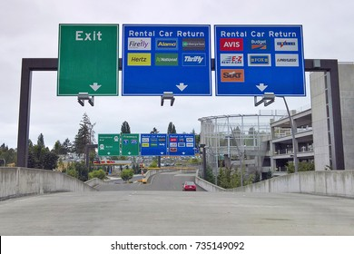 SEATAC, WA - AUGUST 27, 2016: Roadway signage at Seattle-Tacoma International Airport's Consolidated Rental Car Facility guides customers to the return queues and displays all rental car companies.