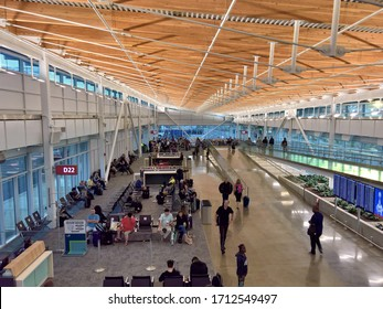 SEATAC, WA - SEPTEMBER 12, 2019 - Passengers wait to board flights at Seattle-Tacoma (Sea-Tac) International Airport in the recently opened bus gates facility.