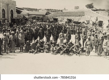 Seated Australian POWs captured at Shellal in the First Battle of Gaza, March 26, 1917. Soldiers of the Egyptian Expeditionary Force are surrounded by their victorious Ottoman Turkish captors.