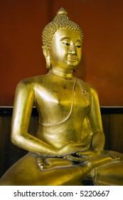 Seated Buddha in Buddhist temple in Ayutthaya near Bangkok, Thailand.