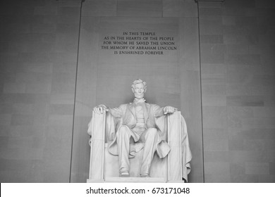 The seated sculpture of Abraham Lincoln, the 16th President of the United States, inside the Lincoln Memorial in Washington D.C.