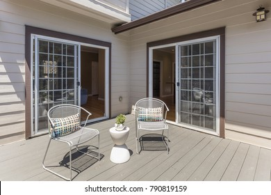 Seating Arrangement on sunny deck showing two sliding doors.