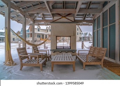 Seating on the snowy patio of a clubhouse in Utah