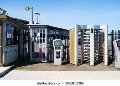 Seatlle, WA USA June 6, 2017: Seattle, Washington ferry terminal pedestrian entrance with various security measures including fencing, gates and turnstiles