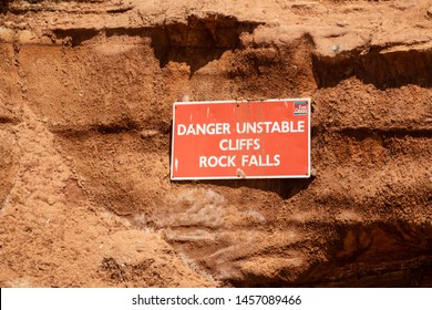 Seaton, Devon, England, UK. June 2019. Danger sign of cliffs and rock falls along the Jurassic coast at Seaton, Devonshire