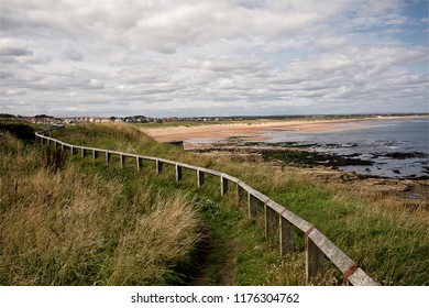 Seaton Sluice beach in Northumberland viewd from the cliff tops on Rocky Island. The beach is a four mile stretch of sand in North East England between Seaton Sluice and the mouth of the River Blyth.