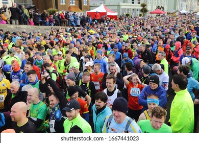 SEATON, UK-MARCH 8, 2020: Start of multi terrain 20 mile The Grizzly race in Seaton, Devon featuring 2000 runners.